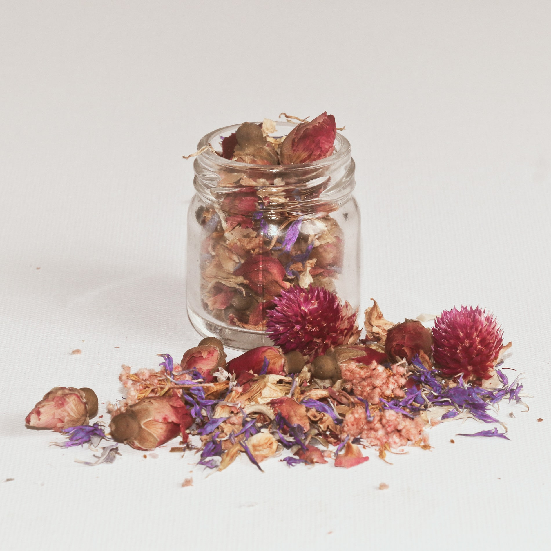 Glass jar filled with dried flowers