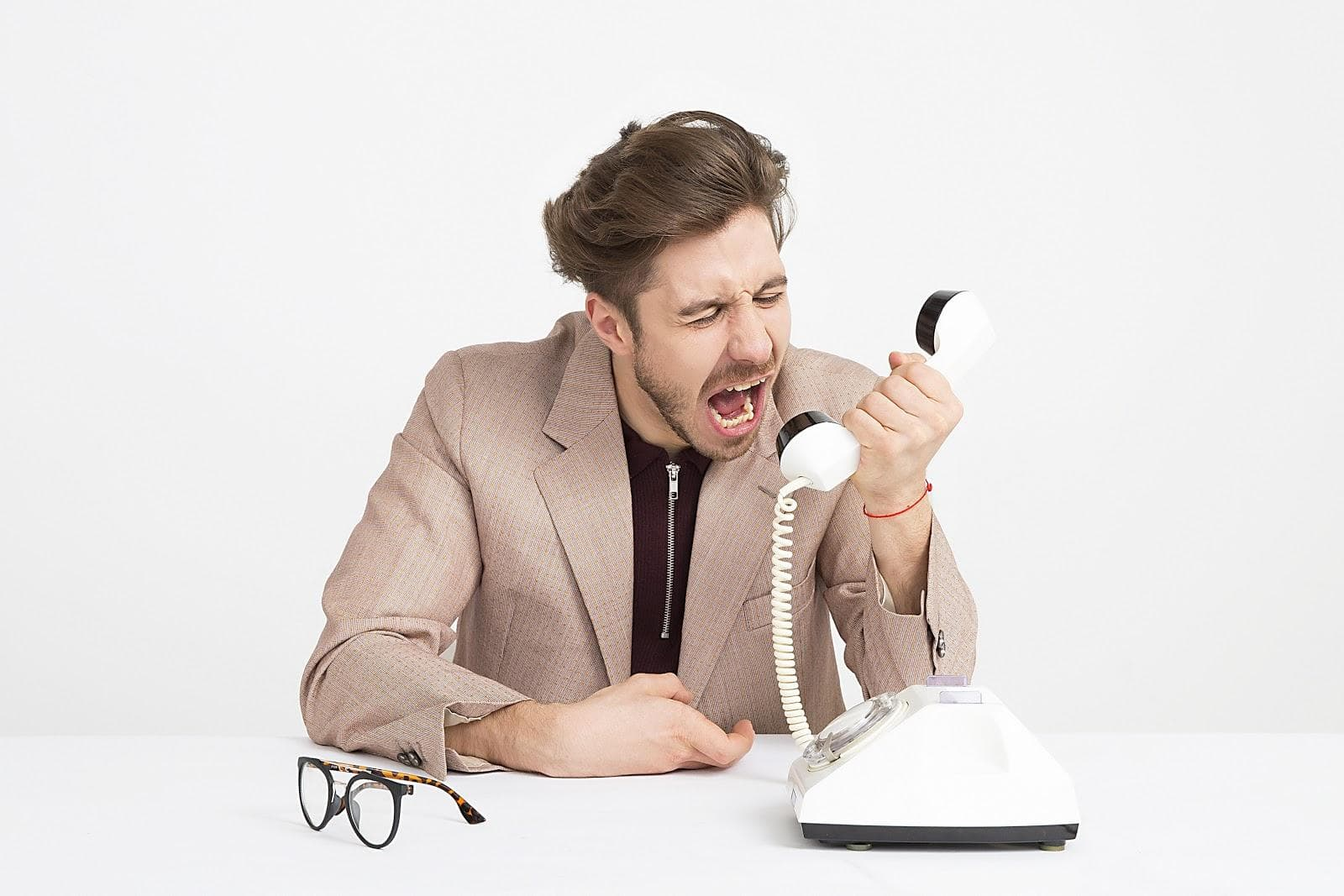 Person yelling into telephone
