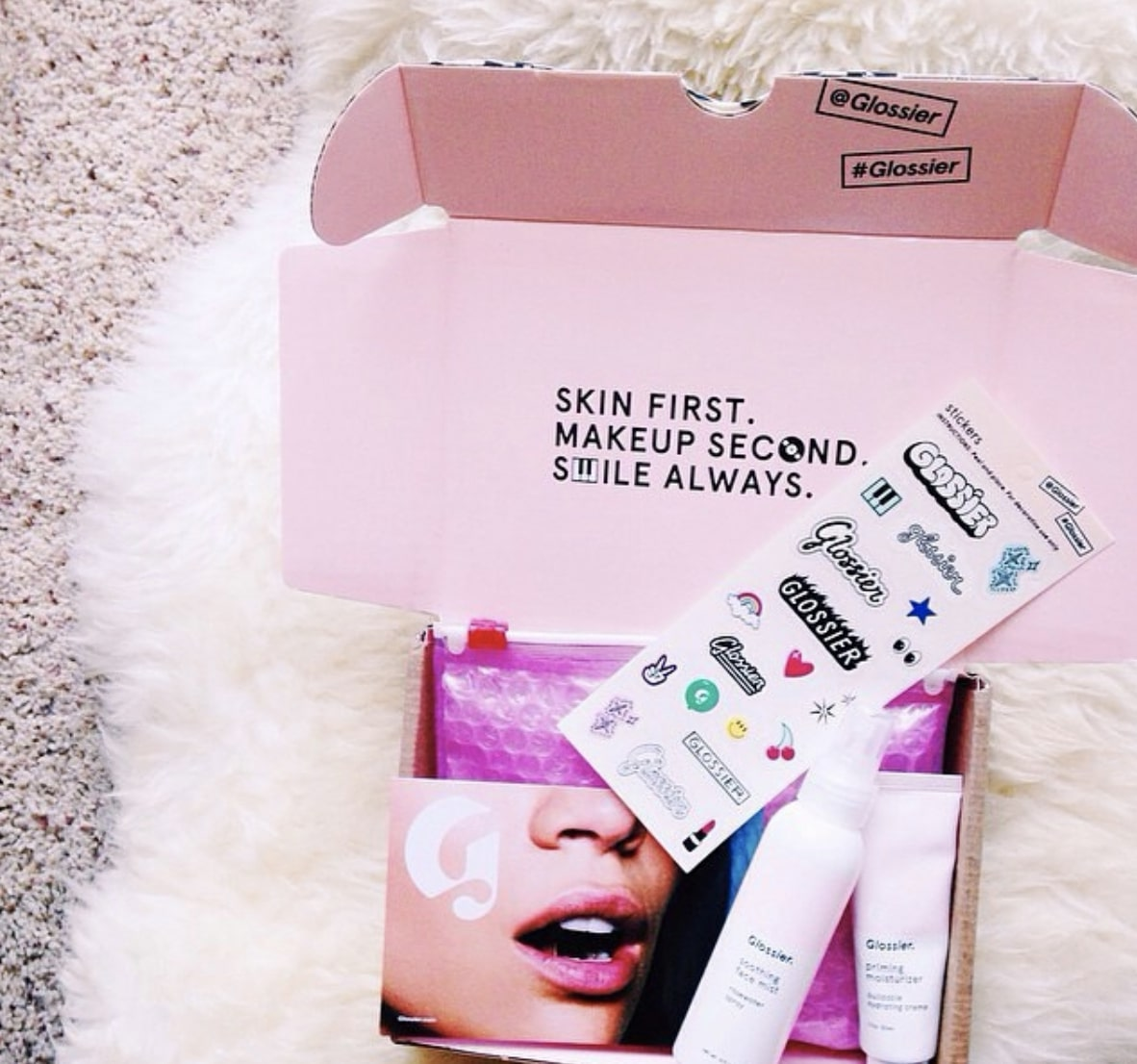 Branded eCommerce packaging by Glossier
