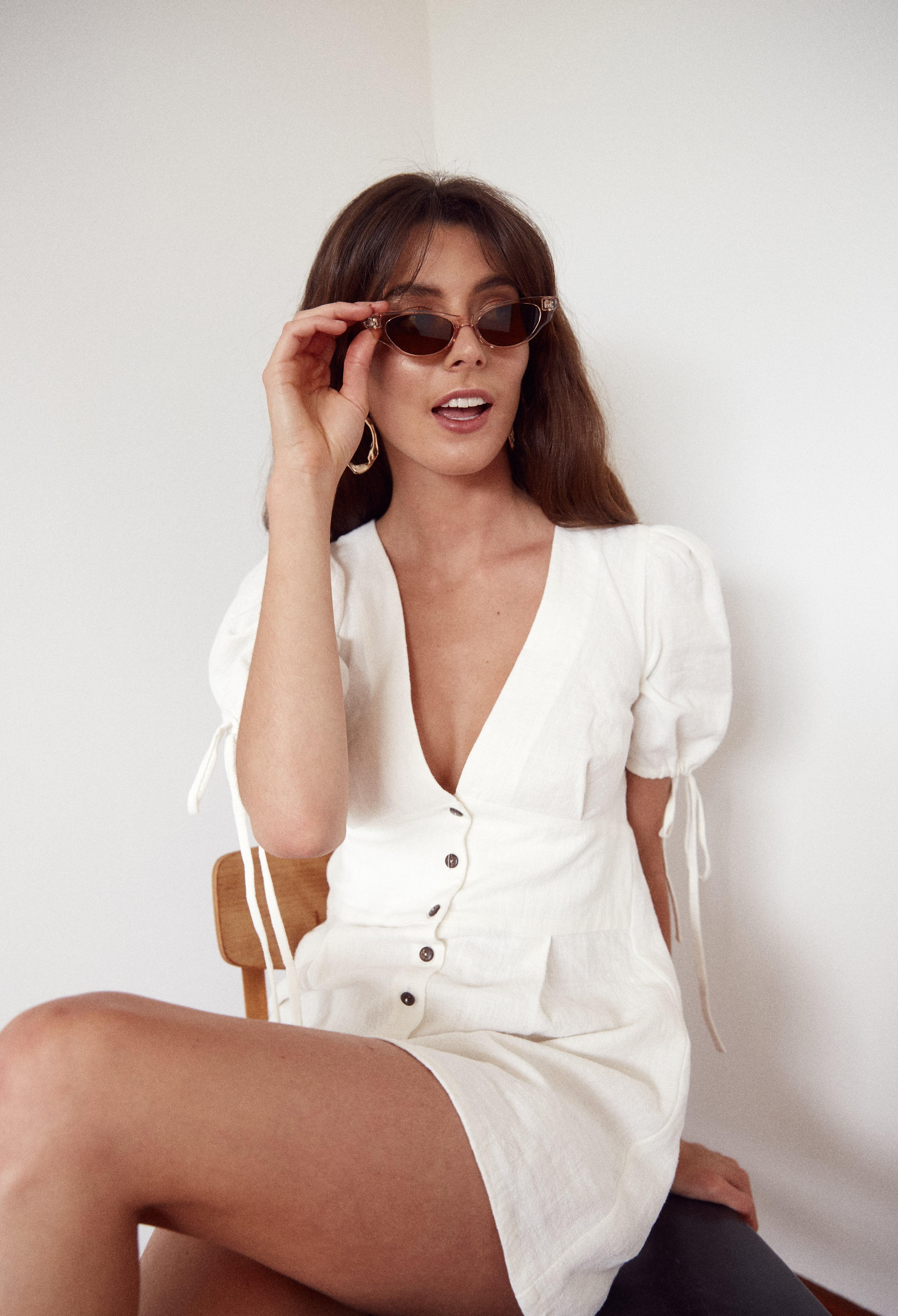 Model wearing cats-eye sunglasses